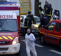 French police officer shot dead outside Paris, suspect at large