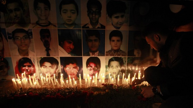 A candlelight vigil is held in Lahore for the 134 children killed in the school attack. Photo: Reuters
