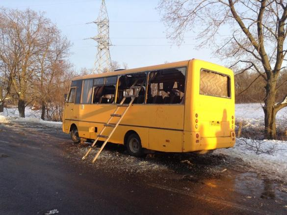 Bus shelled near Ukraine military checkpoint.