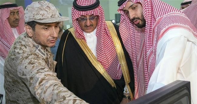 The picture provided by the Saudi Press Agency (SPA) on March 26, 2015 shows Saudi Defence Minister Mohammed bin Salman bin Abdul Aziz (R) and Crown Prince and Interior Minister Mohammed bin Nayef bin Abdul Aziz (C) meeting with Saudi Air Force officers to discuss plans and developments of the military operations against Yemen, at the command and control center of the Air Force in Riyadh.