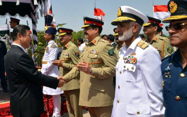 Chinese President Xi Jinping shakes hands with Army Chief Raheel Sharif after arriving at Nur Khan air base in Rawalpindi. — AFP