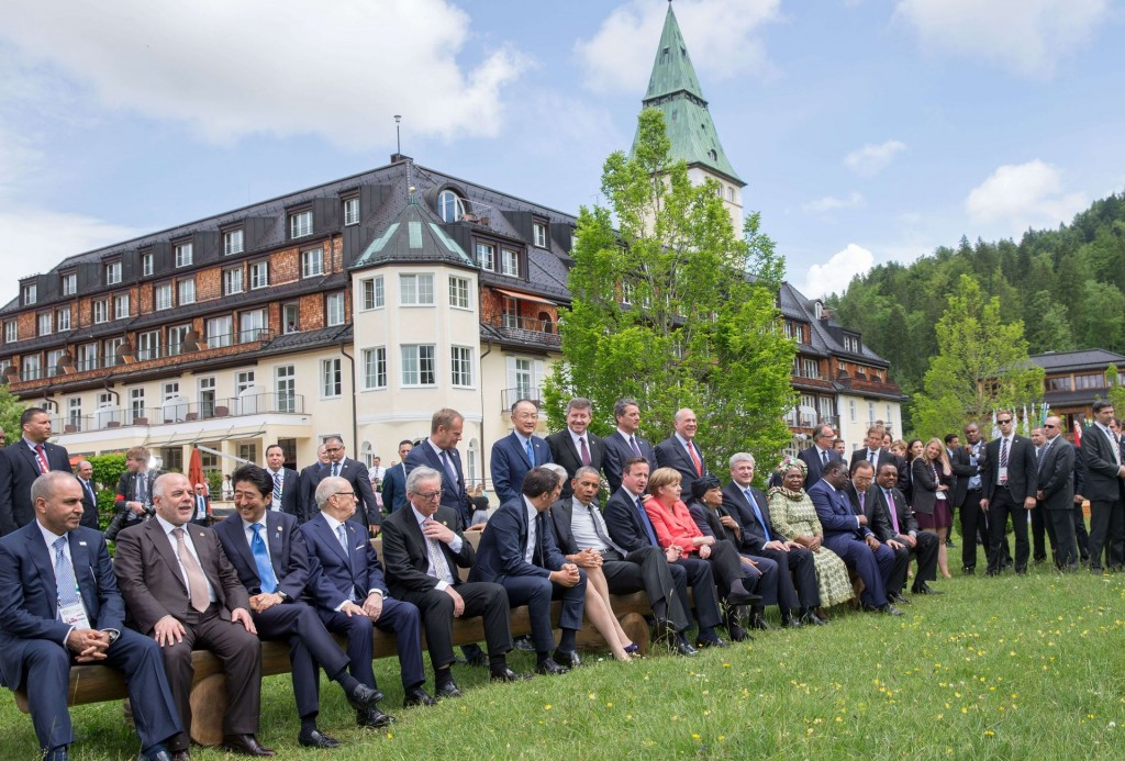 Leaders of the Group of Seven, or G-7, are meeting in Bavaria, Germany, to discuss global economic and security issues, as well as pressing global health-related issues. Attendees sit on a bench outside the meeting venue of Schloss Elmau on June 8.