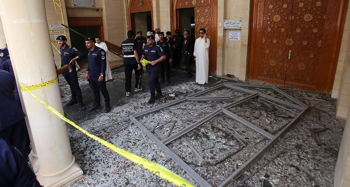 Kuwaiti security forces gather outside the Shiite Al-Imam al-Sadeq mosque after it was targeted by a suicide bombing during Friday prayers on June 26, 2015, in Kuwait City. Photographer: Yasser Al-Zayyat/AFP via Getty Images