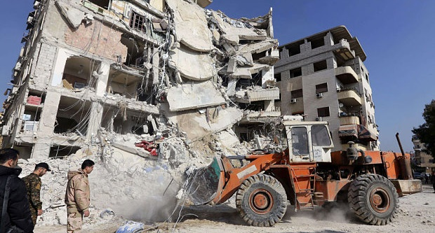 A bulldozer clearing debris from the site of a reported Israeli air raid in Lebanon. Photo: AFP/Getty