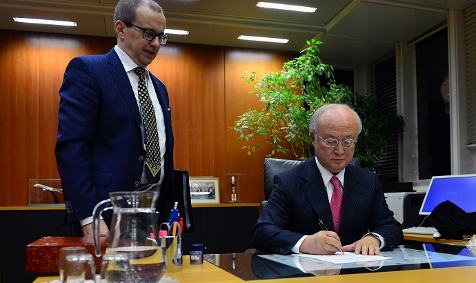IAEA Director General Yukiya Amano clears for release the report on 'Verification and Monitoring in the Islamic Republic of Iran in light of United Nations Security Council Resolution 2231 (2015.' (Photo: D. Calma/IAEA)