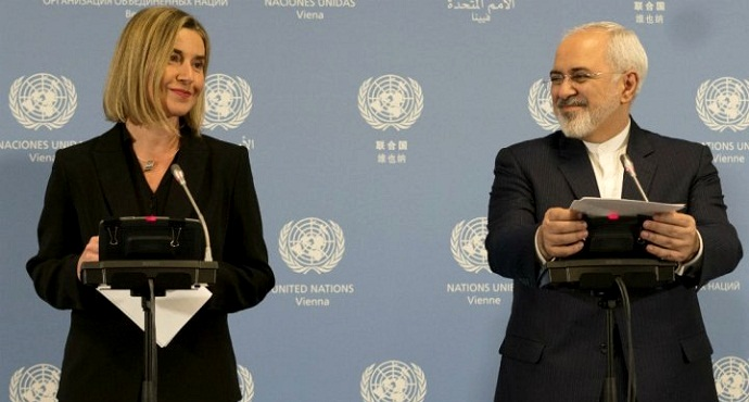 Iranian Foreign Minister Mohammad Javad Zarif (R) and EU foreign policy chief Federica Mogherini at a joint press conference at the IAEA headquarters in Vienna on January 16, 2016.