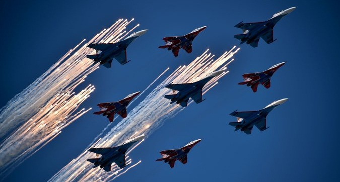 MiG-29 jet fighters of the Strizhi (Swifts) and Su-27 jet fighters of the Russkiye Vityazi (Russian Knights) aerobatic teams fly in formation during the Victory Day parade Photo: Getty Images