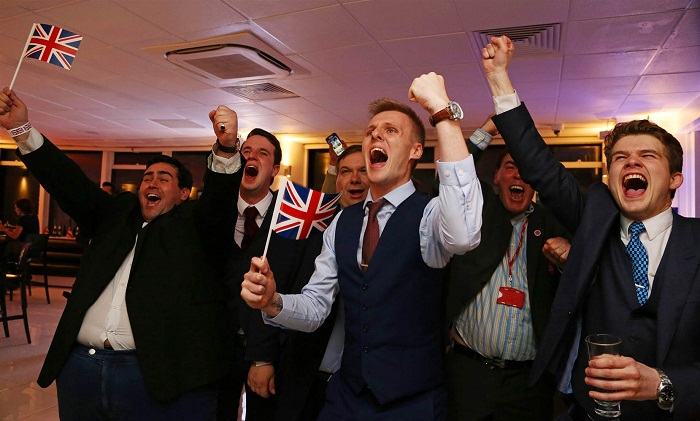 """Leave"" supporters cheer as results come in at a London party early Friday. Geoff Caddick / AFP - Getty Images"