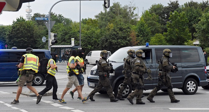 Policemen arrive at a shopping centre in which a shooting was reported in Munich, southern Germany, Friday, July 22, 2016