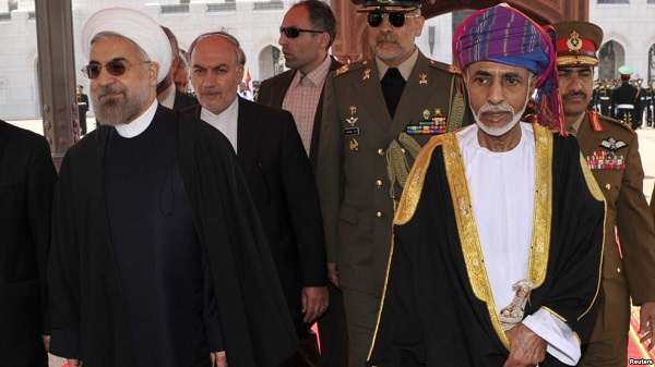 Oman's Sultan Qaboos bin Said (R) walks with Iran's President Hassan Rouhani upon Rouhani's arrival in Muscat, Oman, March 12, 2014. (Photo Credit: Reuters)