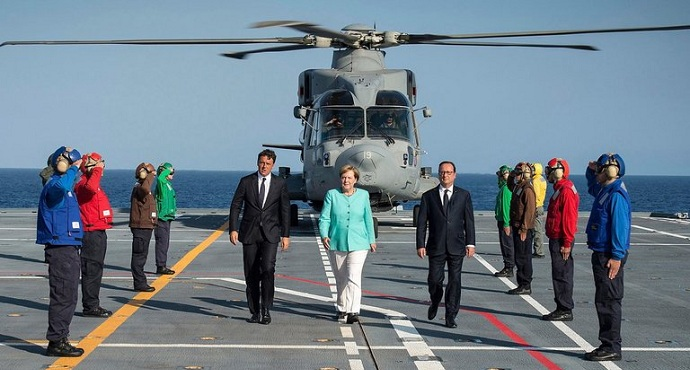 Italian Prime Minister Matteo Renzi, German Chancellor Angela Merkel (C) and French President Francois Hollande (L) pose on the Italian aircraft carrier Garibaldi off the coast of Ventotene island, central Italy, August 22, 2016.