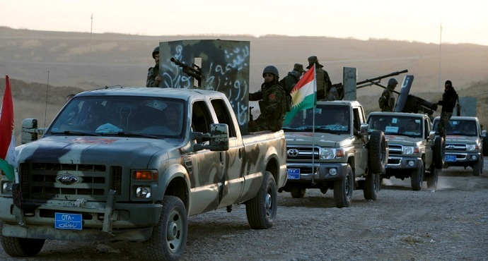 Peshmerga forces in the east of Mosul as they prepare to attack ISIL positions [Azad Lashkari/Reuters]