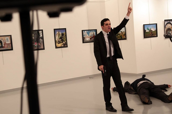 An unnamed gunman gestures after shooting the Russian ambassador to Turkey, Andrei Karlov, at a photo gallery in Ankara, Turkey on Monday. Photo: Burhan Ozbilici/Associated Press