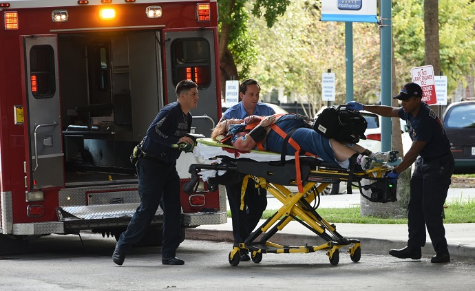 An injured woman is taken into Broward Health Trauma Center in Fort Lauderdale, Fla., after a shooting at the Fort Lauderdale-Hollywood International Airport on Friday, Jan. 6, 2017.  Photo: Taimy Alvarez