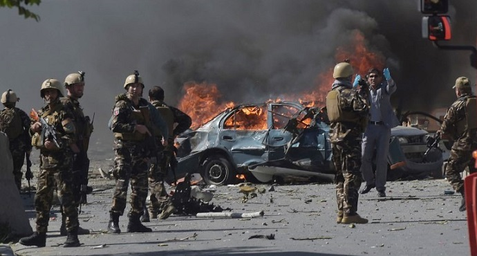 Afghan security forces patrol the site of a deadly suicide bomb attack in Kabul, Afghanistan, on Wednesday, May 31.