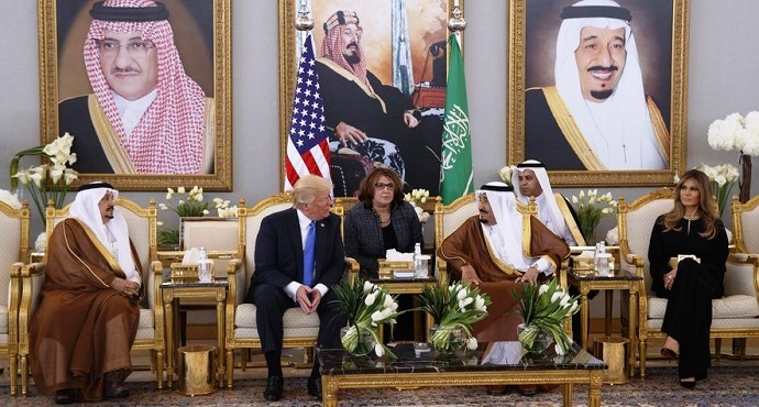 President Donald Trump meets with Saudi King Salman after a welcome ceremony at the Royal Terminal