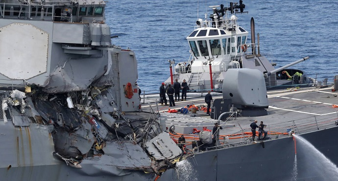 This picture shows damages on the guided missile destroyer USS Fitzgerald off the Shimoda coast after it collided with a Philippine-flagged container ship on June 17, 2017. AFP via Getty Images