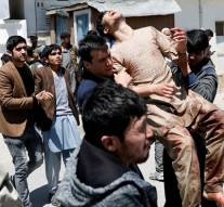 Two deadly blasts in Afghanistan kill 63