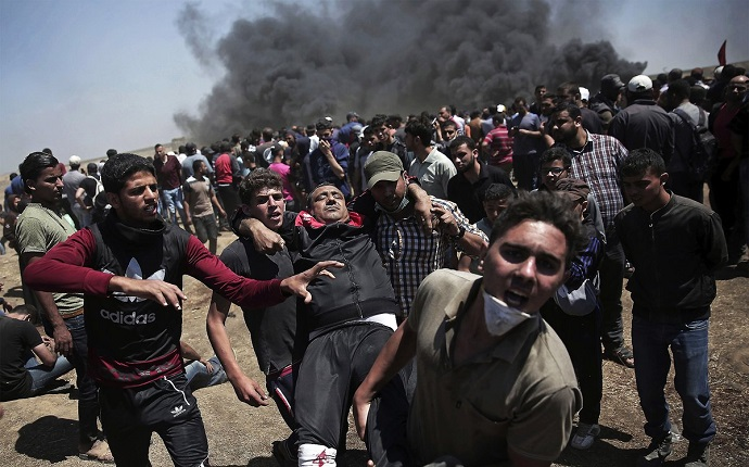 Israeli troops fatally shot dozens of Palestinian demonstrators on the Gaza border on Monday as the US Embassy formally moved to Jerusalem from Tel Aviv.