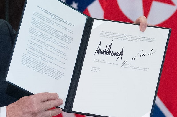 Trump holds up a document signed by him and Kim Jong Un. Photo: Saul Loeb/AFP via Getty Images