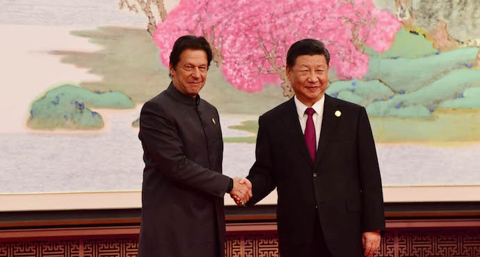 Chinese President Xi Jinping welcomes Prime Minister Imran Khan at the Opening Ceremony of the China International Import Expo at Shanghai, China on November 5, 2018 .