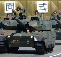 China warns Japan to 'remain on the pathway of peace'