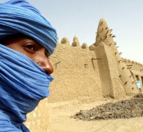 Mali government signs peace deal, rebels coalition ask for more time