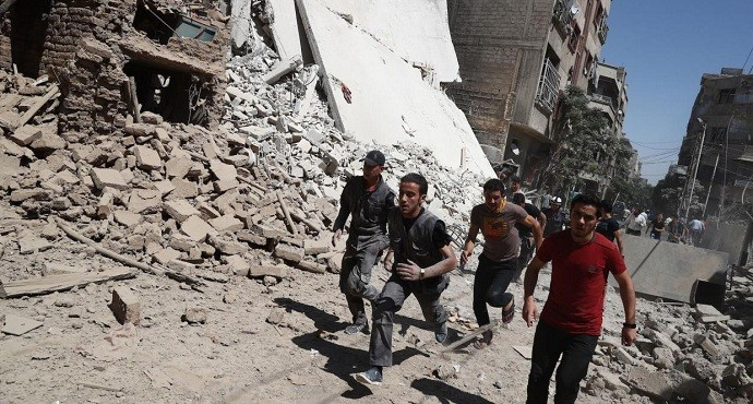 Airstrikes in Syria kill at least 100, hours after U.S.-Russia ceasefire deal