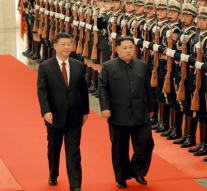 North Korea's Kim Jong Un meets Xi Jinping on surprise visit to China
