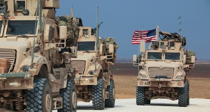 Kurdish fighters evacuate besieged Syrian border town